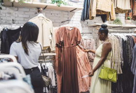 Two young women shopping for clothes at Bird Bee